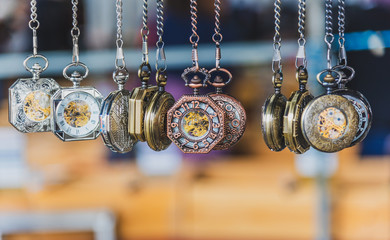 A row of hanging reproduction pocket watches for sale at the Queen Victoria Market in Melbourne Australia