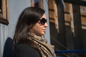 Beautiful woman with sunglasses enjoying at the sun