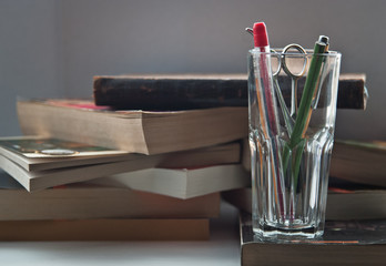 stationery in glass and books