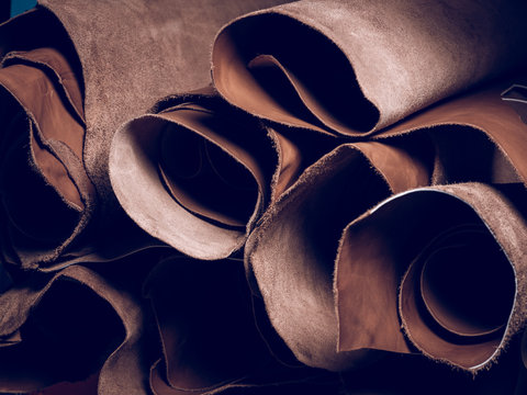 Stack of brown leather in workshop