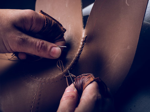 Crop hands stitching leather for shoes