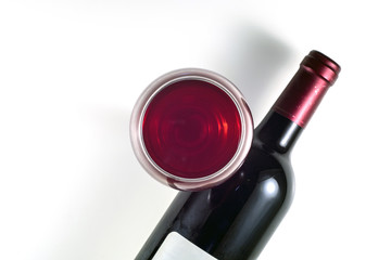 Fototapeta  A glass and a bottle of red wine on a white background. View from above. obraz