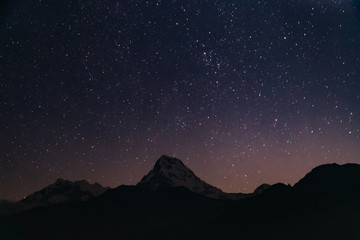 Snow Peak of Annapurna Mountain at Night with Stars in the Himalayas in Nepal