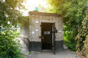 Refuge from a nuclear war in a residential courtyard. Old Soviet bomb shelter protection from the atomic bomb.  shelter, bomb, basement, atomic, explosion, war, nuclear, storage,