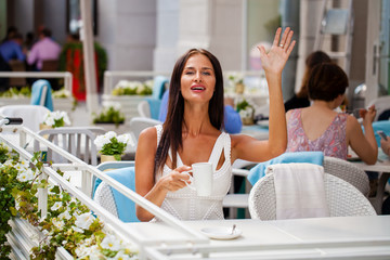 A woman relaxing with a drink coffee