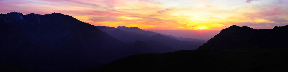 contrasting sunset high in the mountains panorama Wall mural