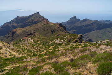 View of the Macizo de Teno mountains, Masca Gorge and mountain road to the village of Maska. Tenerife. Canary Islands. Spain. View from the viewpoint - Mirador De Cherfe.