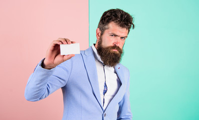 Bearded hipster serious face show card. Banking services for business. Business card design. Card copy space professional occupation position. Feel free contact me. Businessman hold blank card