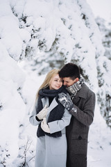 Love story in the winter forest. Valentine's Day concept