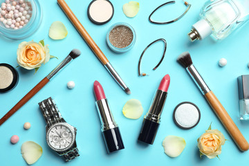 Flat lay composition with lipstick on color background