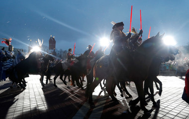 People dressed as historic characters take part in a march on Christmas Eve in centre of Minsk