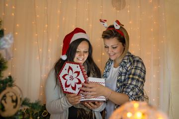 Two beautiful girls open a surprise box on New year night