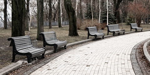Broken park benches in the fall.