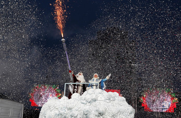 People dressed as Father Frost and Snow Maiden take part in a march on Christmas Eve in centre of Minsk