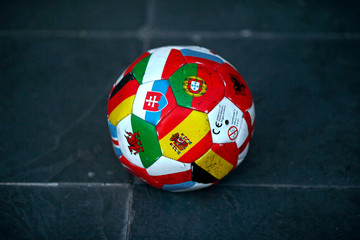 A ball made with flags of countries is seen on a street in downtown Malaga