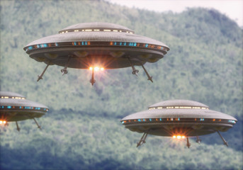 In de dag UFO Three unidentified flying objects over a forest with trees and mountains behind.