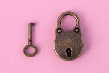 bronze key and padlock on gently pink paper, background image Wall mural