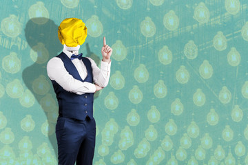 Wall Mural - a man in a suit with a light bulb of crumpled yellow paper instead of a head with a raised finger, the concept of the idea, on the background of light bulbs