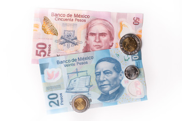 Coins and banknotes of Mexico in different denominations - The Mexican peso on white background