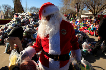 A firefighter dressed as Santa Claus is seen during the annual gift-giving event organized by the Fire Department, in which they hand out items donated throughout the year to children in need, in Ciudad Juarez