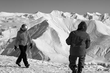 Fototapete - Two skiers on top of high snowy mountain