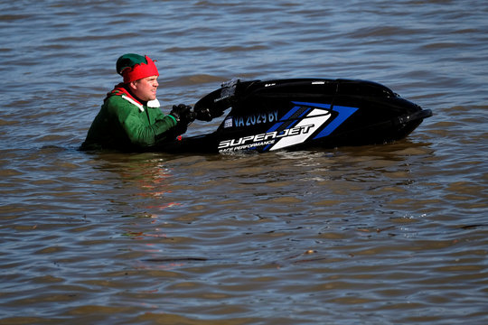 A jet skiing elf makes his annual Christmas Eve appearance along the waterfront in Alexandria, Virginia