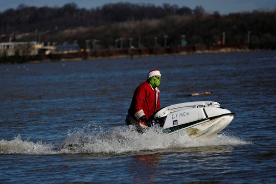 The jet skiing Grinch makes his annual Christmas Eve appearance along the waterfront in Alexandria, Virginia
