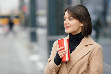 Woman Drink Her Hot Coffee While Walking On The Street. Portrait Of Stylish Smiling Woman In Winter Clothes Drinking Hot Coffee. Female Winter Style. - Image