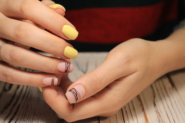 Abstract New Year design on women's nails.