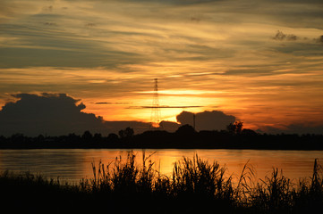 Silhouette landscape Sunset on the river Sky and clouds of orange