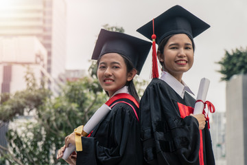 Asian female graduated student posing for photography after graduation