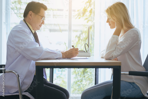 Happy And Smiling Woman Talking To Doctor Psychiatrist In Hospital