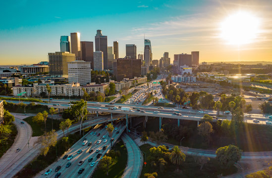 Drone shot of heavy traffic in urban Los Angeles causing CO2 emissions, pollution and climate change.