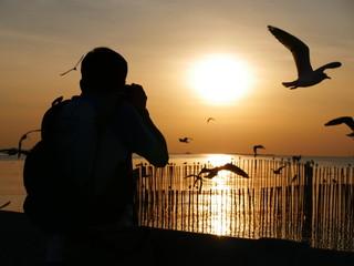 The man take the sunset photo at Bangpu Recreation Center ,Samut Prakan THAILAND.