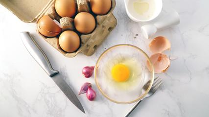 Fresh yolk egg in a glass bowl