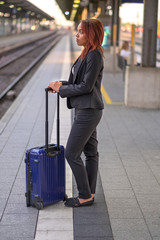 Young businesswoman waiting on a platform