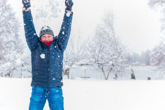 Happy senior man at winter snowy day having fun. Life of pensioner man, positive lifestyle