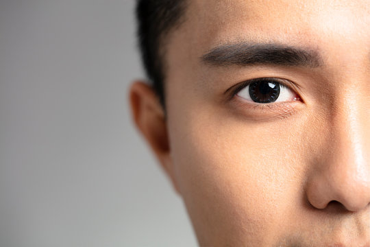 half face of Handsome asian young men