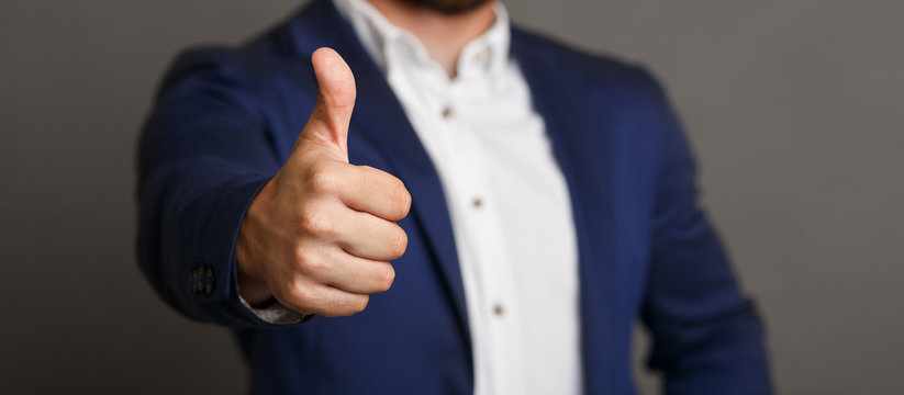 Unrecognizable businessman showing thumb up gesture panorama