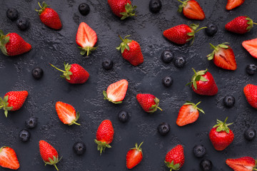 Blueberry and strawberry pattern on black background