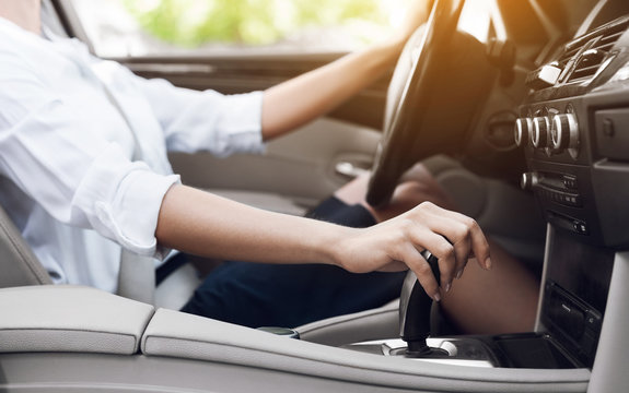 Business woman driver shifting automatic transmission and driving
