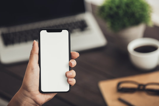 Hand holding smartphone with big blank screen