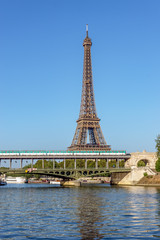 Metro crossing Bir-hakeim bridge with Eiffel Tower in background - Paris, France
