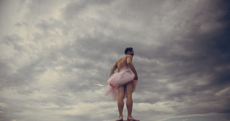 Funny man freak. Man in ballerina skirt outdoor. Crazy ballerina. drag queen. Inspiration and dreaming. Man dancing in tutu in ballet studio. Enjoying carefree time. playful guy. happiness.