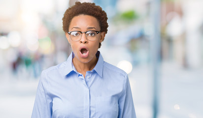 Young beautiful african american business woman over isolated background afraid and shocked with surprise expression, fear and excited face.