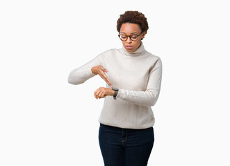Young beautiful african american woman wearing glasses over isolated background In hurry pointing to watch time, impatience, upset and angry for deadline delay