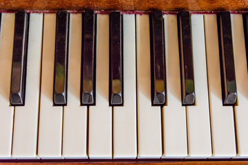 Closeup of the black and white piano keys. Top view