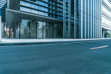 Fotomurales - clean asphalt road through office block area,suzhou,china.
