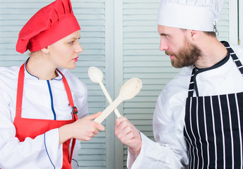 Who cook better. Ultimate cooking challenge. Culinary battle of two chefs. Couple compete in culinary arts. Kitchen rules. Culinary battle concept. Woman and bearded man culinary show competitors