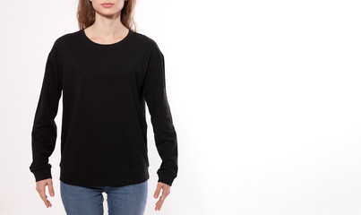 young woman in black sweatshirt, black hoodies front view isolated on white background